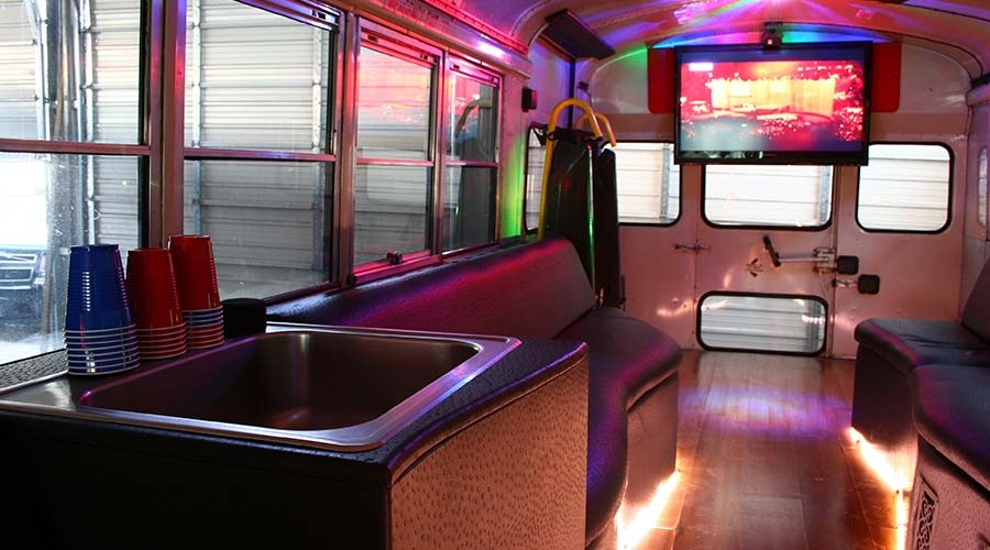 Our Biggest Party Bus Accommodates 30 People And Features Hardwood Flooring Custom Vinyl Seating Two Large Flat Screen Televisions A Sink Area